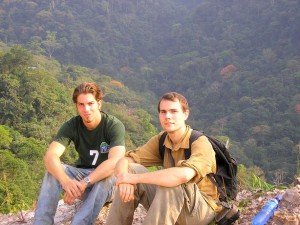 Devin Edmonds and Mark Pepper sit with rainforest in the background