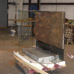 A large custom vivarium with a custom DIY background and false-bottom