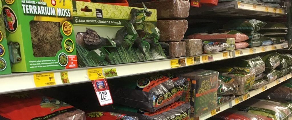 Substrates for reptiles and amphibians on a shelf at a pet store